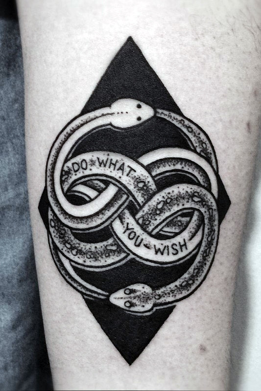 Black rhombus and ouroboros tattoo
