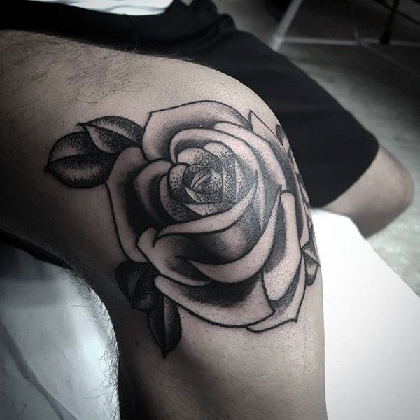 Black rose tattoo on the knee