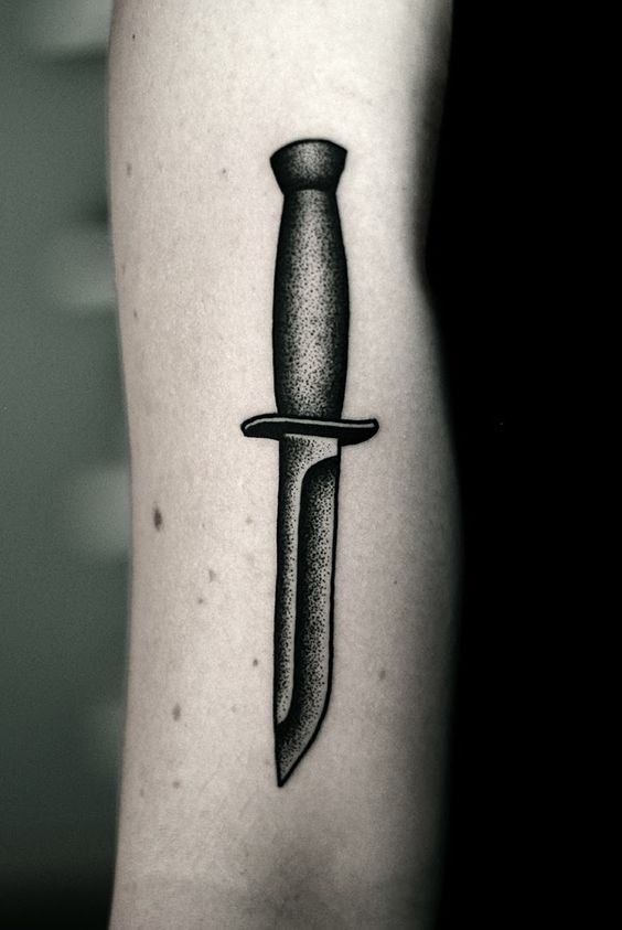 Blackwork style knife tattoo by kamil czapiga