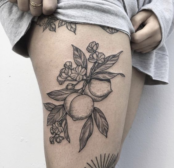 Branch with peaches on the right thigh