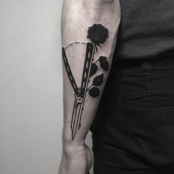 Butterfly knife and black rose tattoo