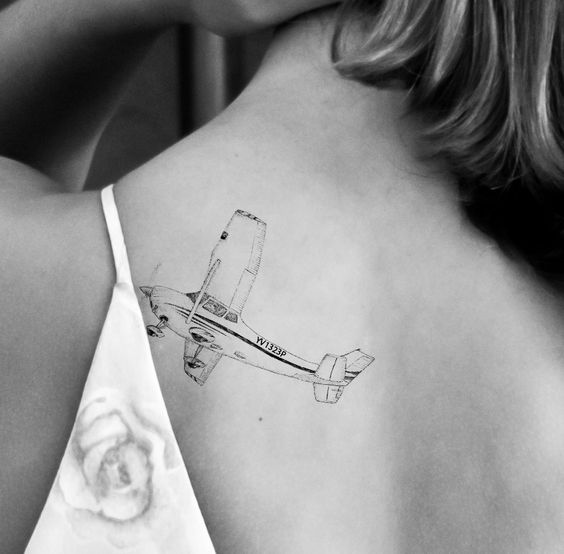 Cessna 182 skylane light airplane tattoo on the back