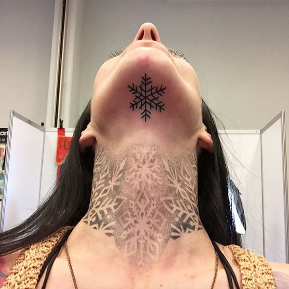 Chin and neck snowflake tattoos