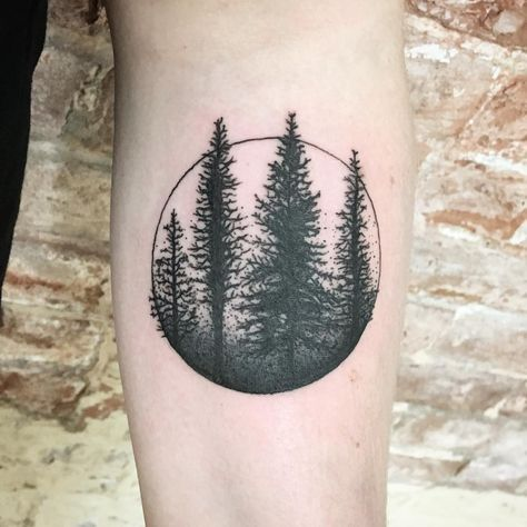 Circular black forest tattoo