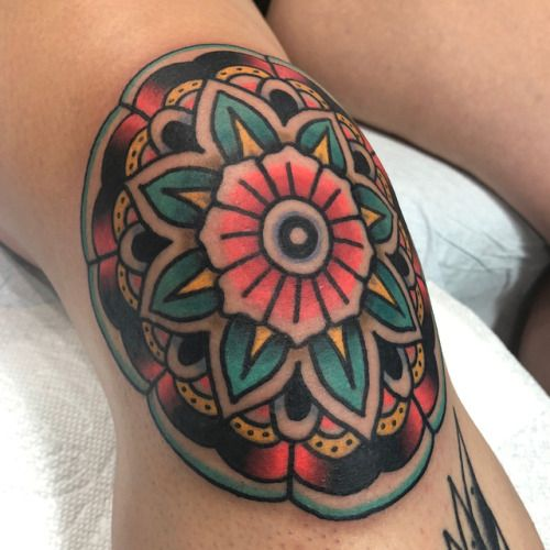 Colorful mandala tattoo on the knee