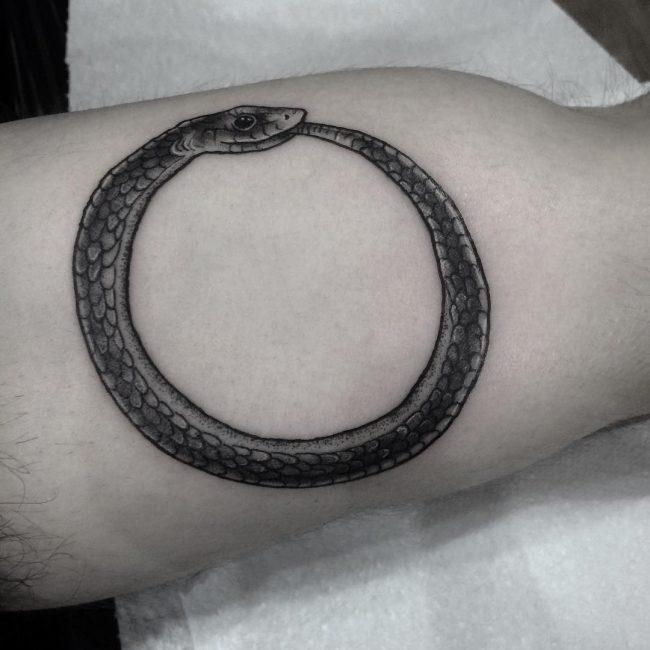 Cute ouroboros tattoo