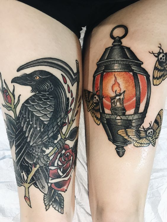 Death moths surround this traditional lantern on the left thigh