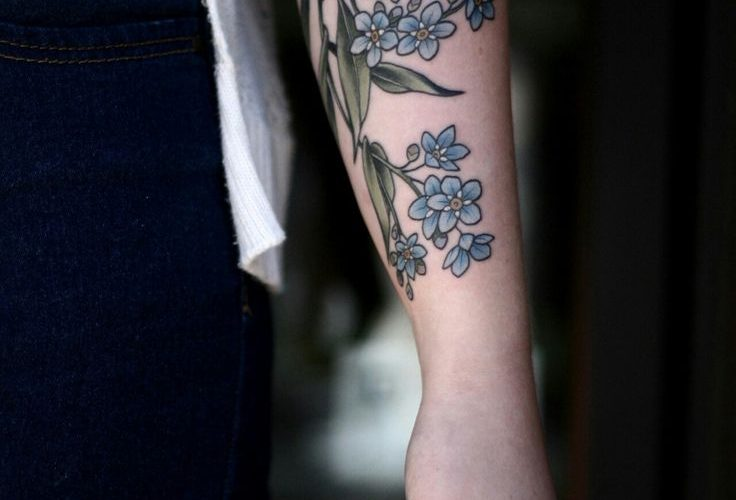 Delicate forget me not tattoo on the left forearm