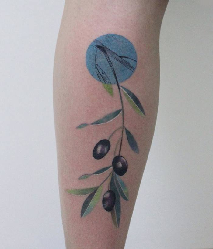 Delicate olive twig tattoo