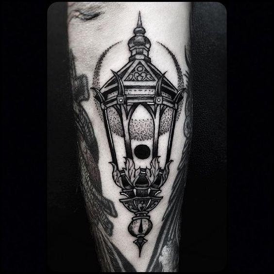 Dotwork style black lantern and crescent moon tattoo