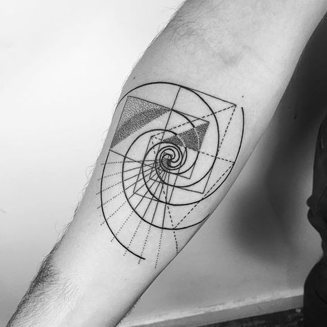 Dotwork style golden spiral tattoo