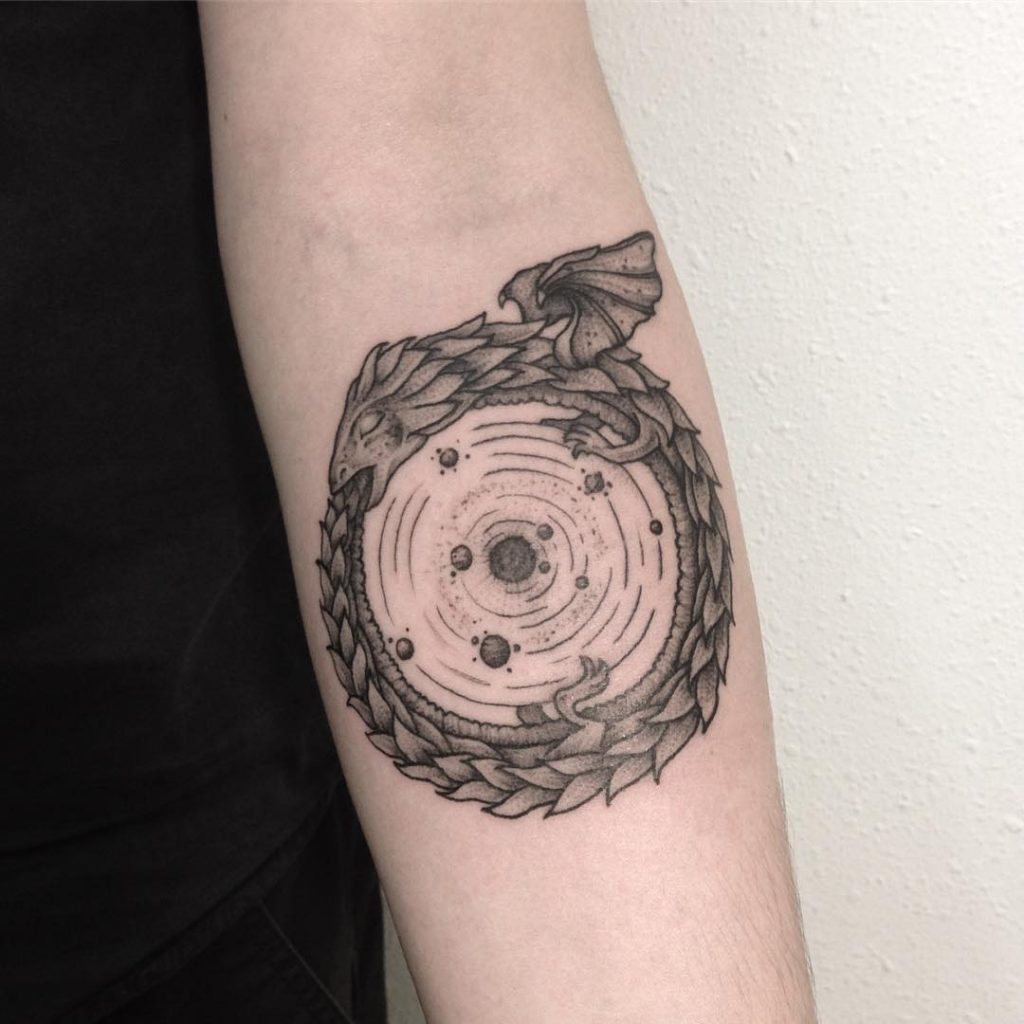 Dragon ouroboros and solar system planets tattoo