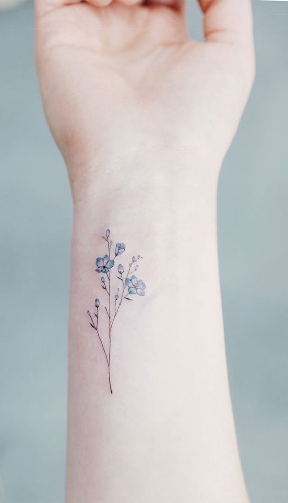 Elegant forget me not tattoo on the inner wrist