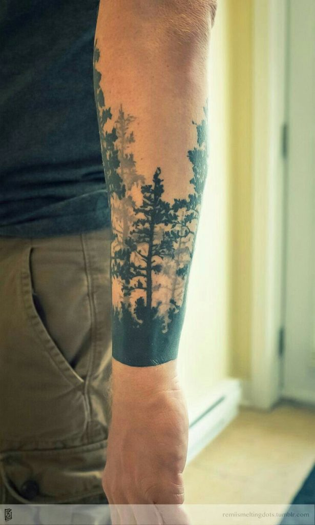 Forest tattoo on the left forearm