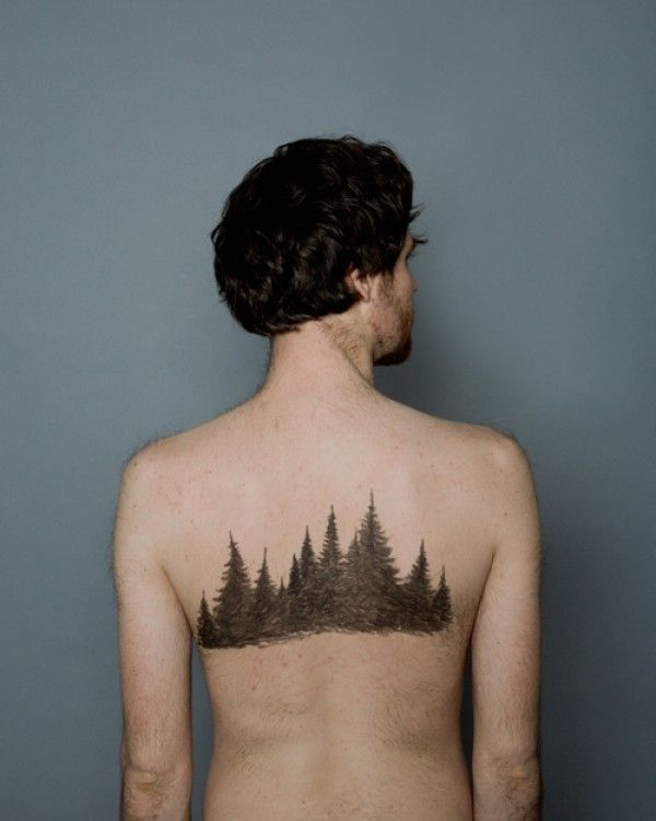 Forest tattoo on the upper back
