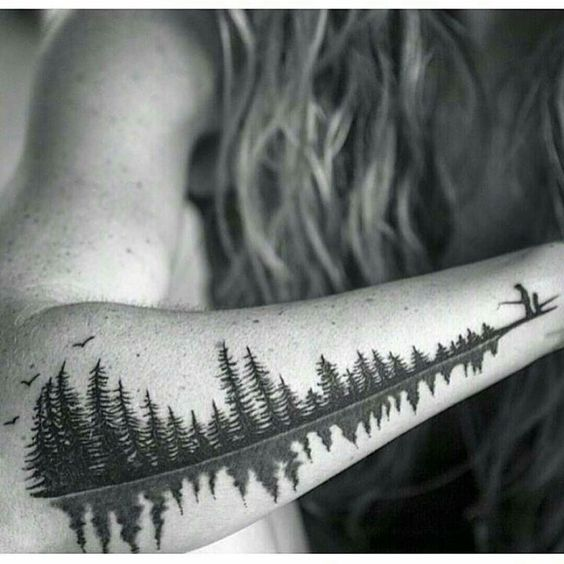 Forest tattoo with a reflection on the lake