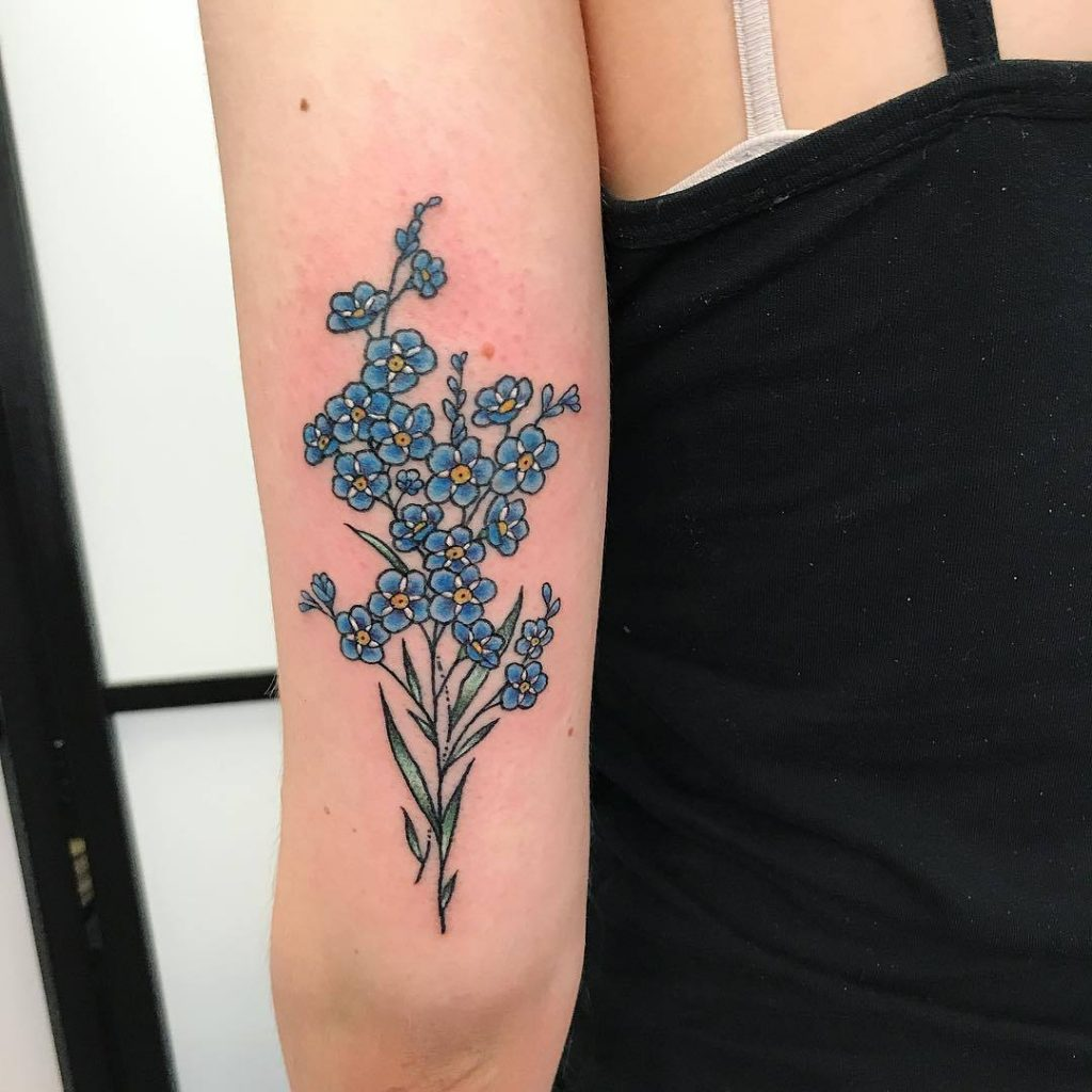 Forget me not flower tattoo on the back of the left arm