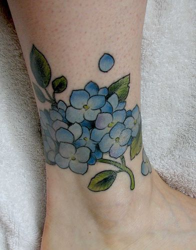 Forget me not tattoo on the ankle