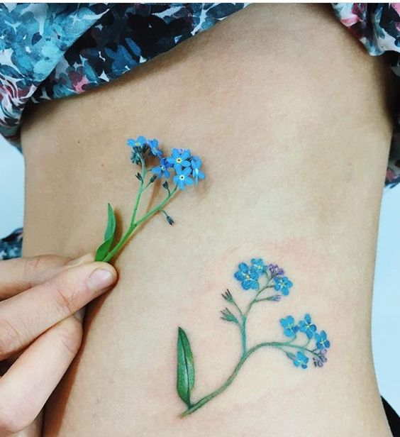Forget me not tattoo on the hip