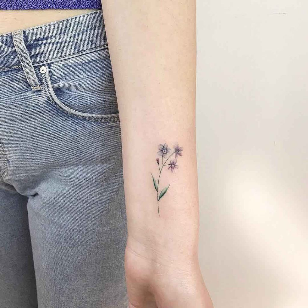 Forget me not tattoo on the left inner forearm