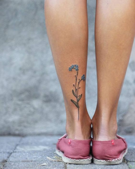 Forget me nots on the left calf