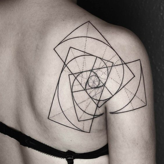 Geometric golden spiral tattoo on the right shoulder blade