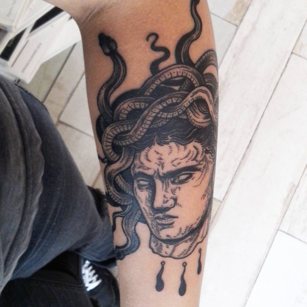 Greek head bust medusa tattoo on the forearm