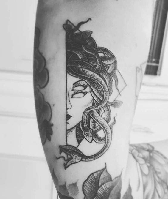 Half face medusa tattoo by christiane hensel