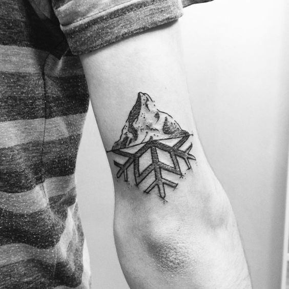 Half snowflake half mountain tattoo
