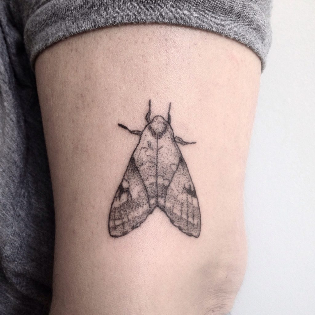 Hand poke moth tattoo
