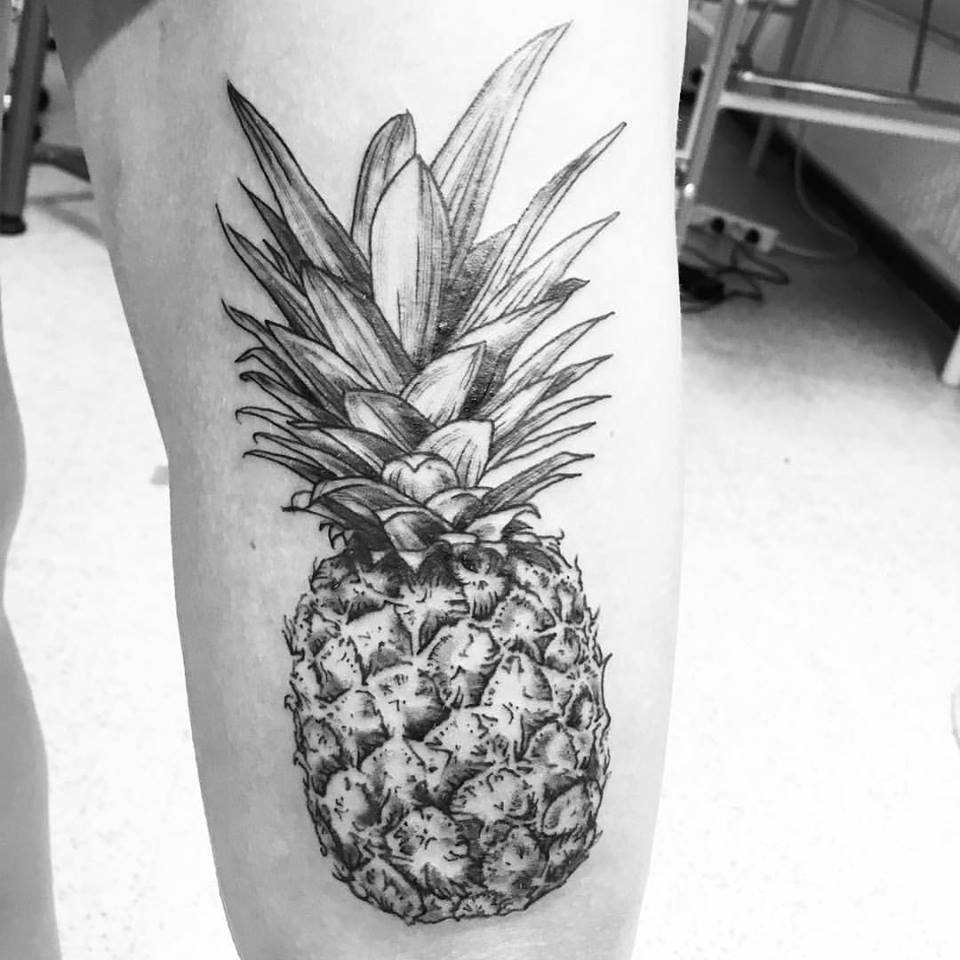 Hyper realistic black and grey pineapple tattoo on the leg