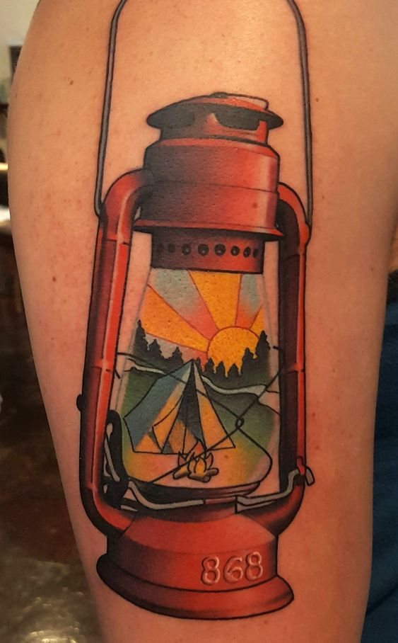 Hyper realistic camping lantern tattoo