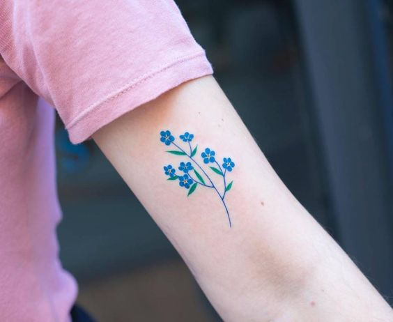 Hyper realistic forget me not on the left upper arm