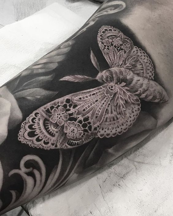Hyper realistic lace moth tattoo