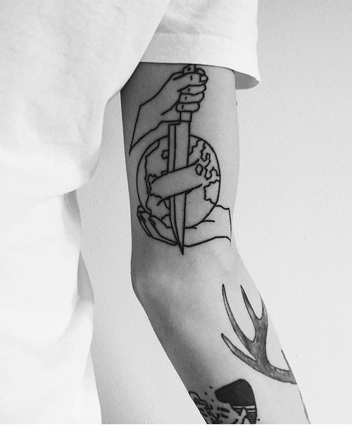Knife stabbed earth tattoo