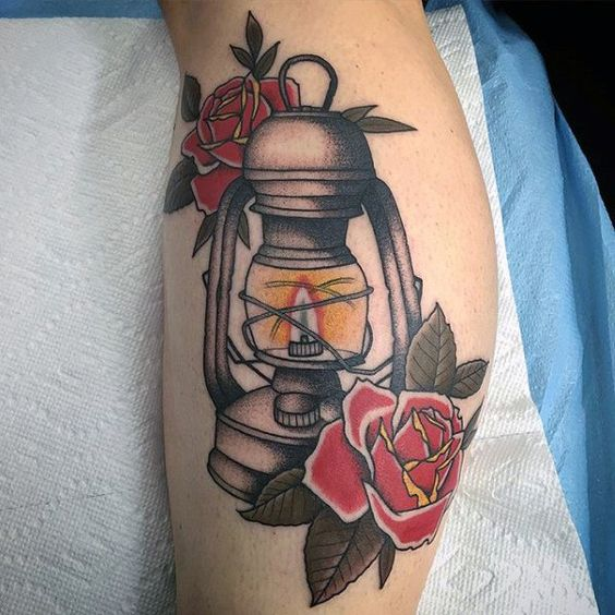 Lantern and red roses traditional tattoo