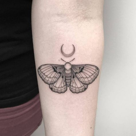 Light moth tattoo in dotwork style