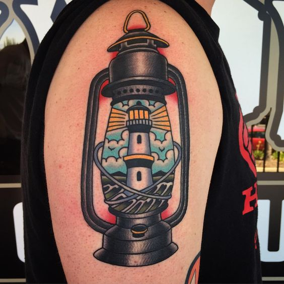 Lighthouse inside a lantern tattoo