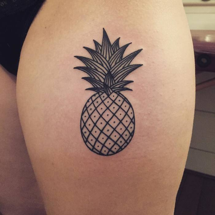 Linear pineapple on the left upper thigh