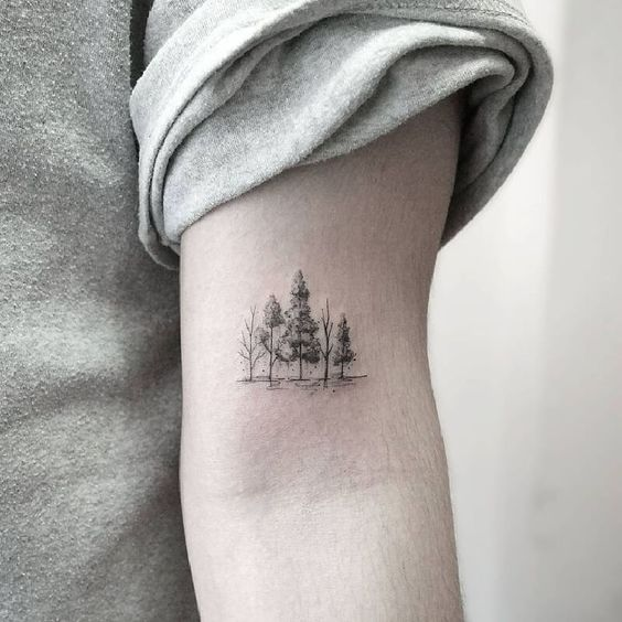 Little forest tattoo on the upper arm