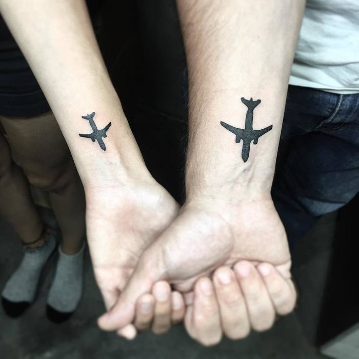 Matching aircraft tattoos on wrists