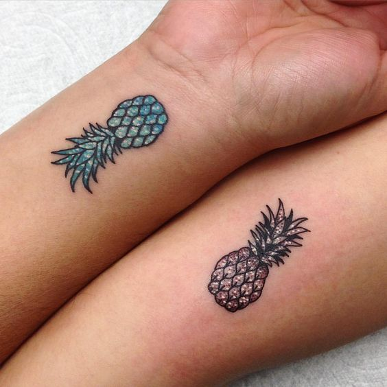 Matching small pineapple tattoos for best friends