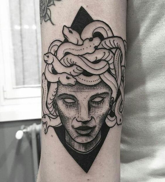 Medusa in a rhombus tattoo by tattooist conio