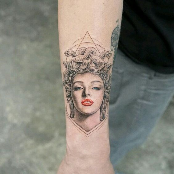 Medusa with red lips on the right wrist