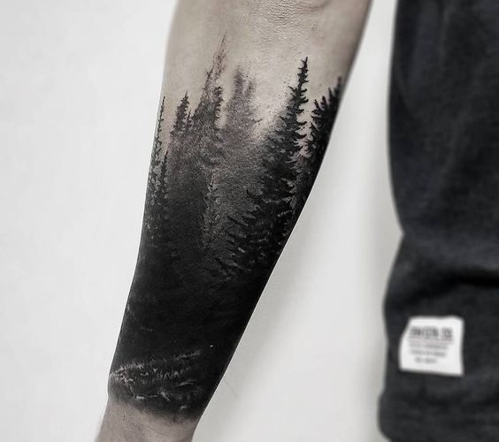 Mesmerizing shading forest tattoo on the forearm