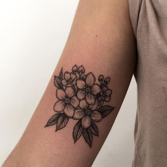 Monochrome forget me nots on the right bicep