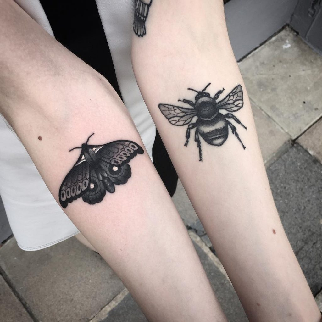 Moth and bee tattoo on both forearms