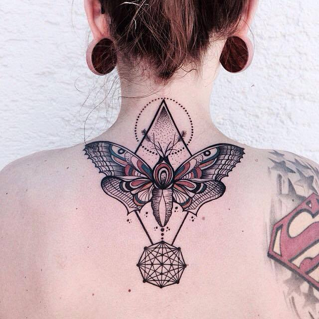 Moth and geometric shapes tattoo on the back