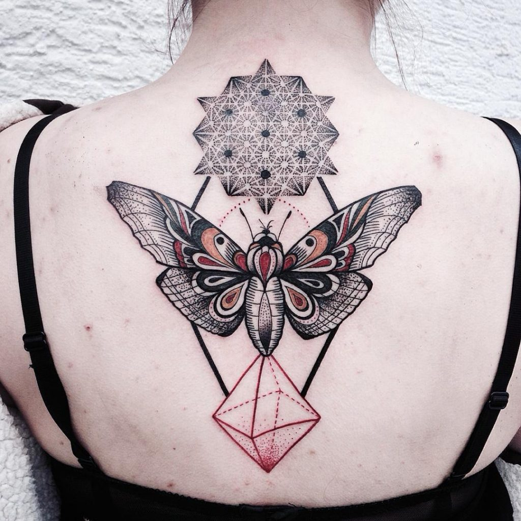 Moth and sacred geometry tattoo on the back