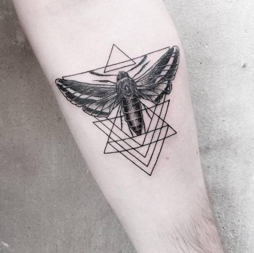 Moth and triangles tattoo